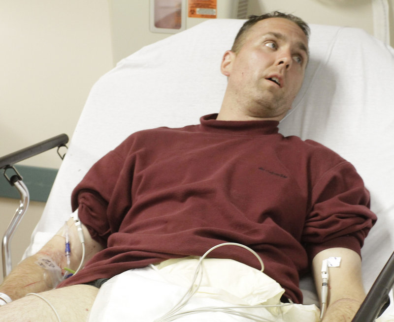 Covered in insect bites and suffering from a crushed kneecap, hiker Michael Hays, 41, of Stow, Ohio, recovers Monday at Millinocket Regional Hospital. Hays, who had been missing since Friday in Baxter State Park, was found Monday by searchers in a helicopter.