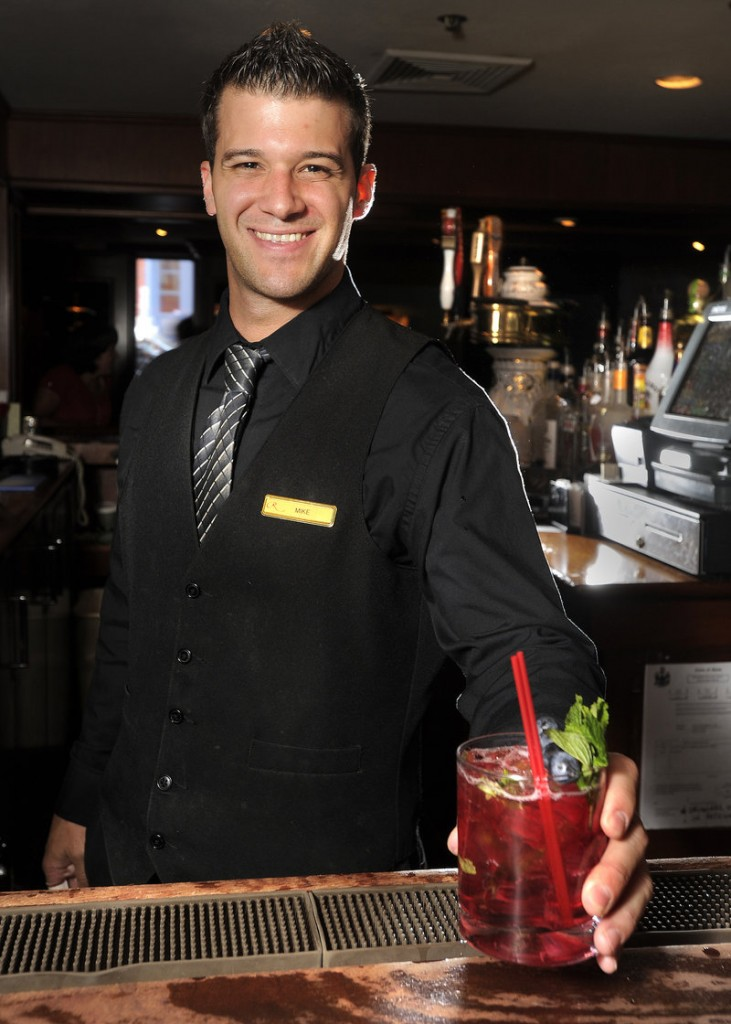Bartender Mike Barris prepares a blueberry mojito at the Armory Lounge at the Regency Hotel in Portland.