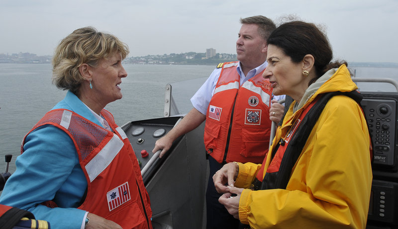 """Sen. Olympia Snowe tours Portland Harbor on Tuesday with Capt. James McPherson, commander of the Coast Guard sector based in South Portland, and Barbara Parker, director of the state DEP's Division of Response Services. """"You've put us in a proactive position"""" for dealing with a massive oil spill off the Maine coast, she told them."""