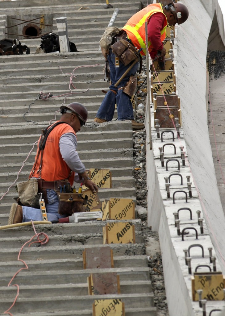 A construction crew works on a site Tuesday in San Diego. The economic recovery gained strength on the biggest rise in construction spending in nearly a decade and the 10th straight month of expansion for the manufacturing sector.