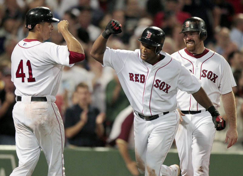 Adrian Beltre, right, is welcomed by Victor Martinez after hitting a three-run homer Tuesday night, and the Boston Red Sox went on to beat the Oakland Athletics, 9-4.