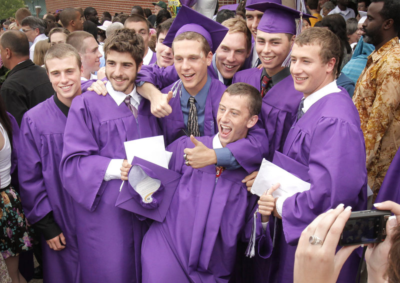 Deering High grads pose for a group photo to mark their time together.