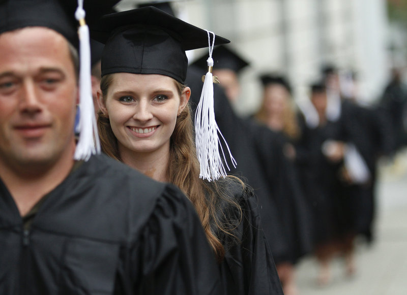 Elizabeth Robinson walks with her classmates during the Portland Adult Education graduation ceremonies Thursday at Merrill Auditorium in Portland. Robinson received a high school equivalency diploma.