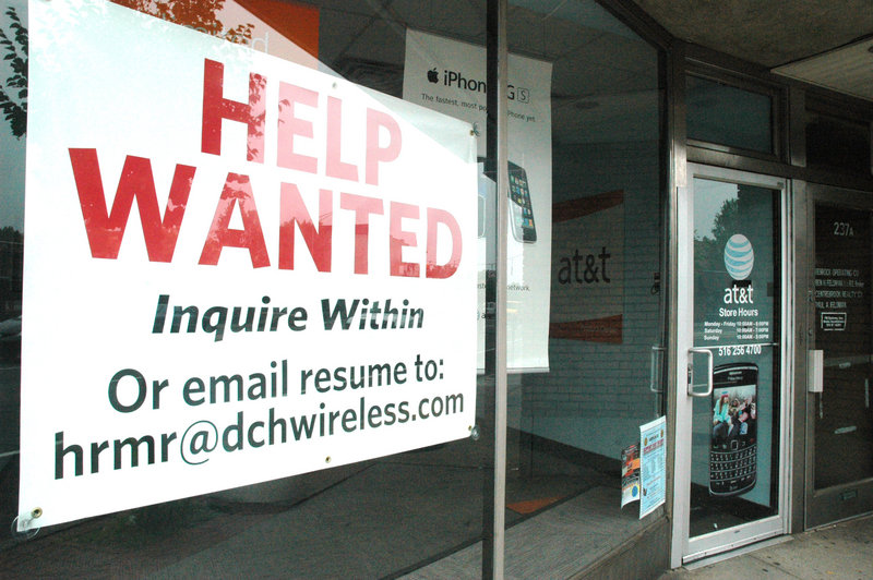 A help wanted sign fills a window at a cell phone store in Rockville Centre, N.Y., Thursday. The U.S. payroll grew by 431,000 last month, spurreds by temporary census hiring, but private payrolls grew at the slowest pace since the start of the year.