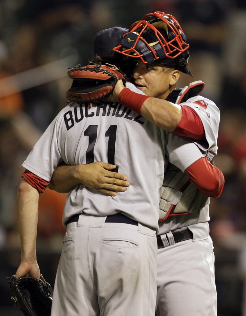 Clay Buchholz savors the win with catcher Victor Martinez on Friday night. Buchholz gave up five hits, struck out one and walked two in the complete-game shutout, his first shutout since he no-hit the Orioles on Sept. 1, 2007.