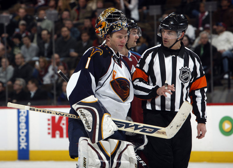 Atlanta Thrashers goalie Johan Hedberg argues with referee Wes McCauley during an NHL game in February against the Colorado Avalanche in Denver.