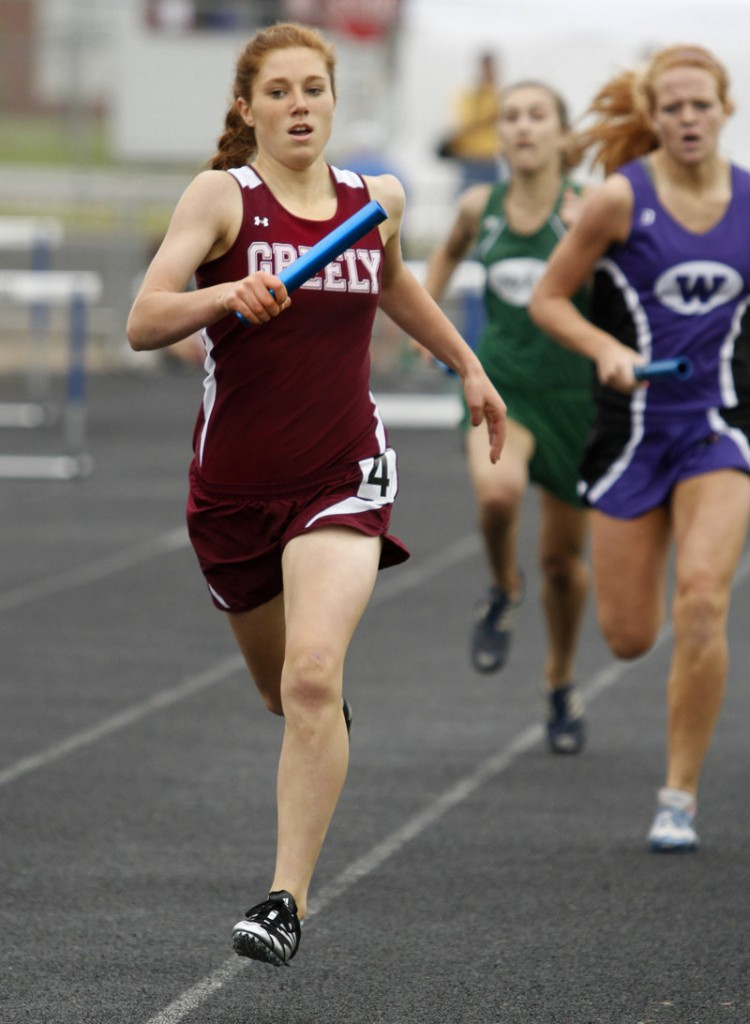 Sara Schad of Greely heads to the finish line Saturday while competing in her portion of the 3,200 relay at the Class B state championships in Windham. Greely won the event.