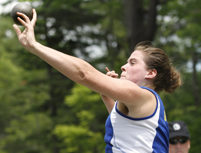 Katie Sparks of Falmouth releases her throw while finishing third in the shot put at 37 feet, 9 inches. Natasha Griffith of Waterville won with a throw of 38-6 3/4.
