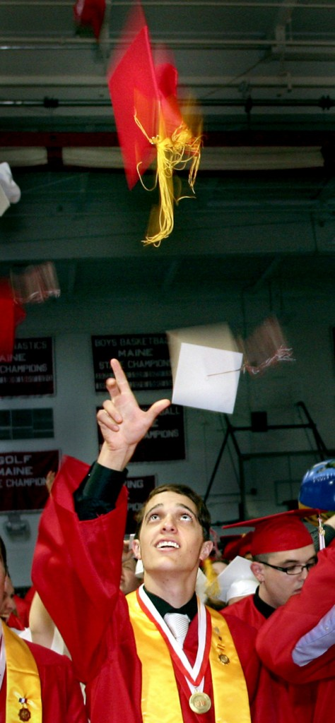 Sam Ouellette tosses his mortarboard in the air at the conclusion of the South Portland High School graduation on Sunday.