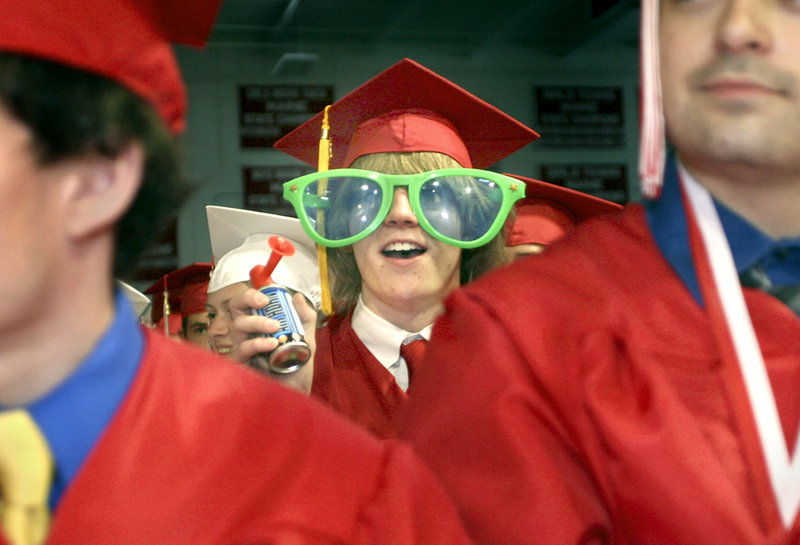 Tyler Wilburn cheers on a fellow graduate during the presentation of diplomas. Some 196 South Portland High seniors were in line to graduate.