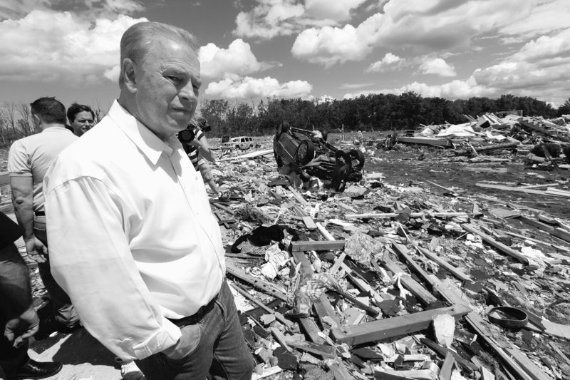 Ohio Gov. Ted Strickland views tornado damage in Millbury, Ohio, on Sunday. Authorities said tornadoes and thunderstorms that swept through the Midwest overnight killed at least seven people, destroyed dozens of homes and damaged a high school gymnasium where graduation was to be held Sunday. The valedictorian's father was killed.