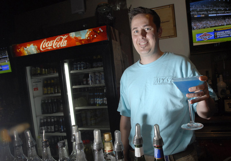 Barkeep Glen Peel of Myst in Old Orchard Beach displays the aptly named Blue Myst Martini.