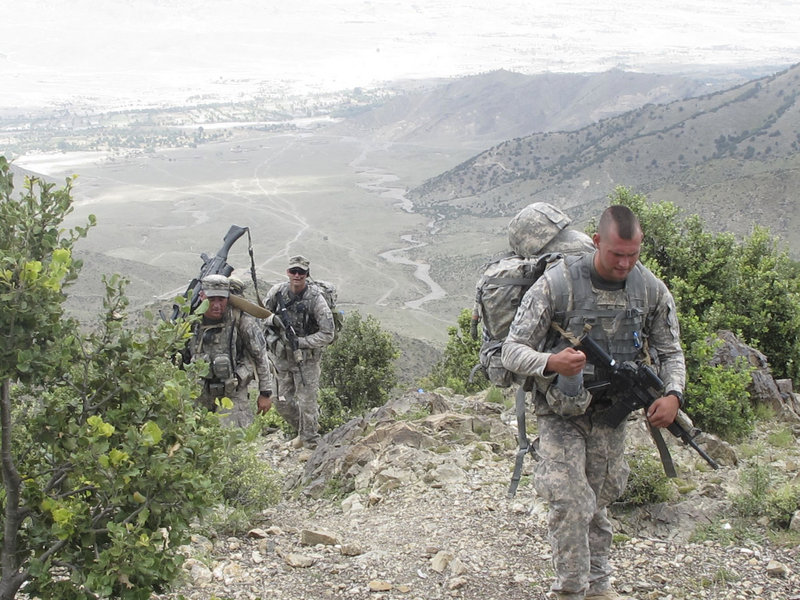 Front to rear, Spc. Peter Donovan of Lisbon Falls, Sgt. Frederick Moody of Gorham and 1st Sgt. John Brooks of Glenburn climb to an observation post manned by Bravo Company, 3rd Battalion, 172nd Infantry.