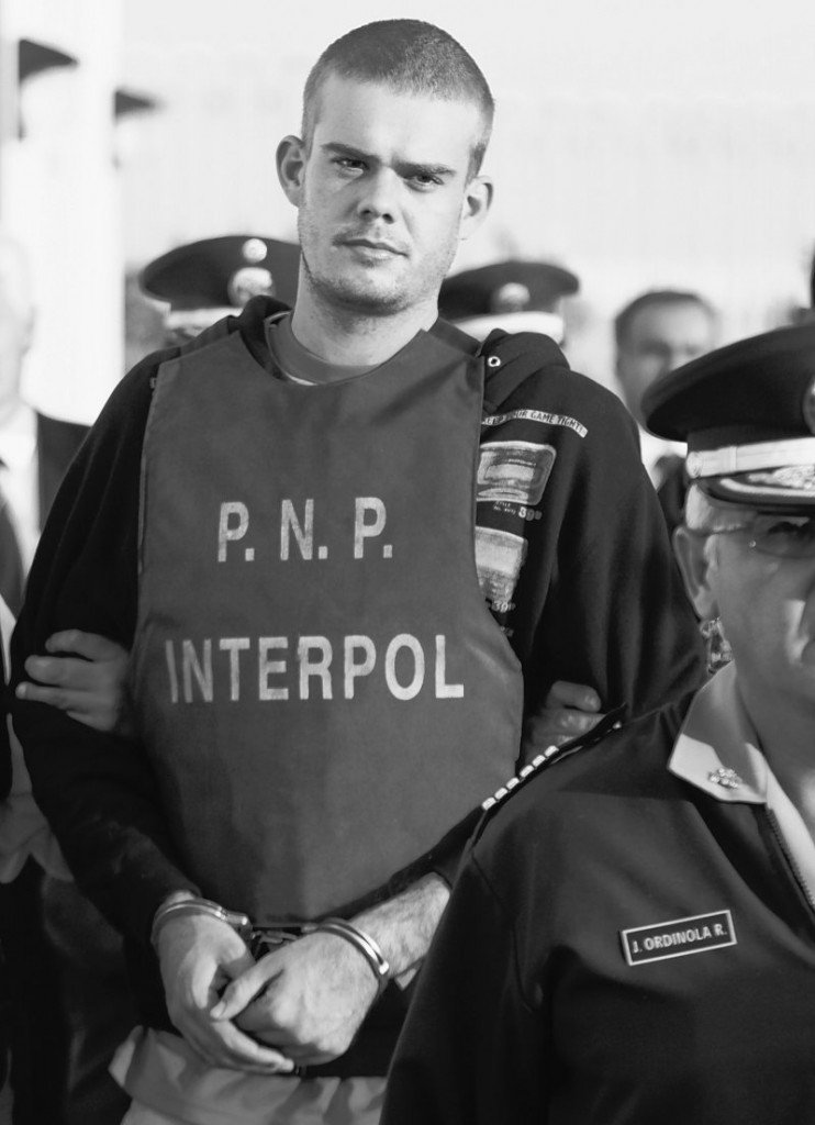 Joran van der Sloot is escorted by police in Tacna, Peru, on Friday. Chilean police turned over van der Sloot, a suspect in the killing of 21-year-old Stephany Flores, to Peruvian police at the countries' border.