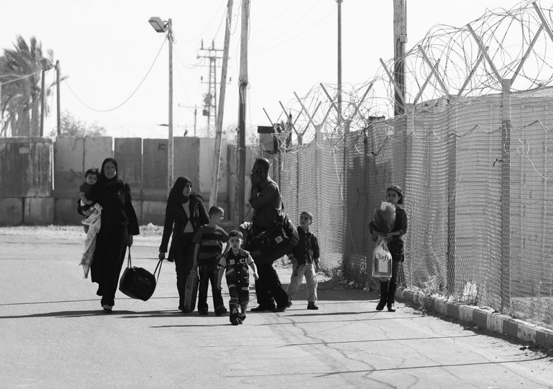A Palestinian family returns to the Gaza strip Monday through the Rafah crossing in Egypt. Keeping the crossing point open long term would ease the blockade imposed by Israel three years ago to isolate and punish Gaza's Hamas rulers.