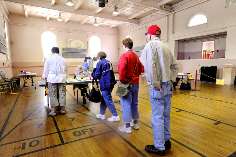 Voters line up at the polls at Portland's Woodfords Street Church on Tuesday.