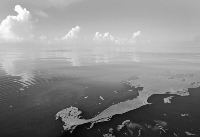 Coagulated oil from the Deepwater Horizon spill floats on the water of Barataria Bay off the coast of Louisiana on Monday. BP says it is collecting about 620,000 gallons of oil a day; government estimates put the overall escape rate at up to 1.2 million gallons per day.