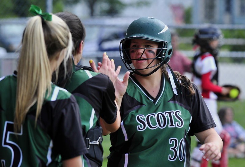 Lindsay Somerset of Bonny Eagle receives congratulations from teammates Tuesday after scoring during the 9-0 victory against Sanford in a Western Class A tournament game.