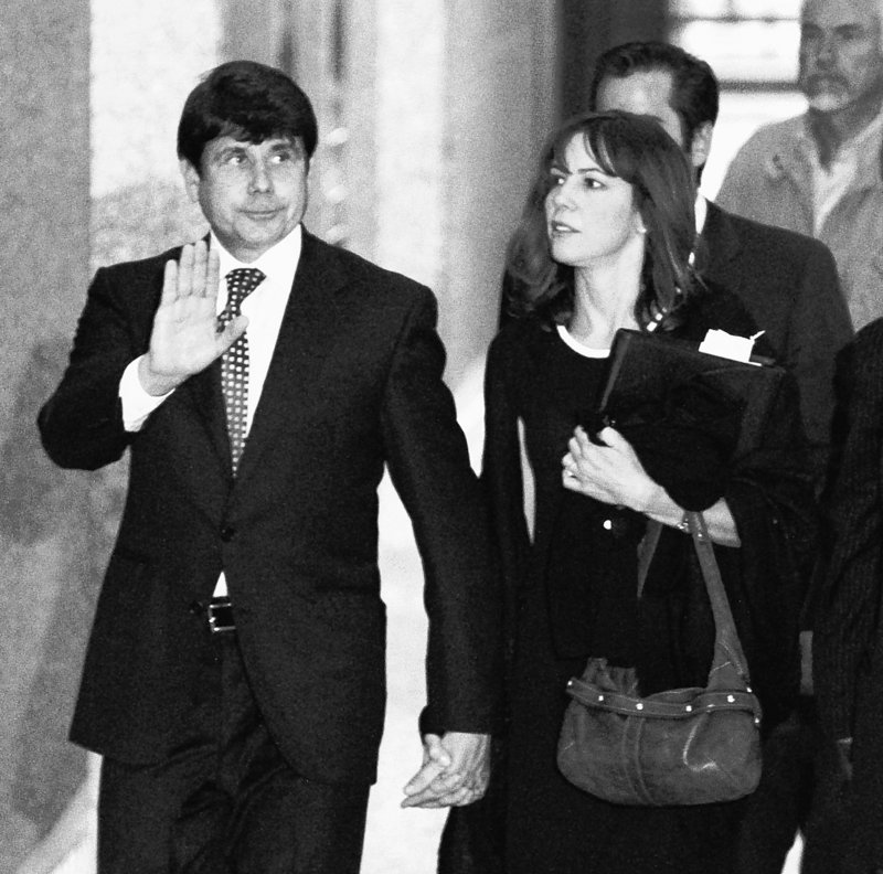 Former Illinois Gov. Rod Blagojevich departs the Federal Court building in Chicago Tuesday with his wife Patti, after opening arguments in his federal corruption trial. His lawyer said Blagojevich was the dupe of members of his inner circle.