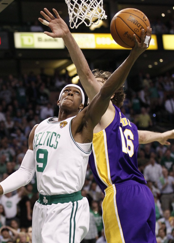 Rajon Rondo of the Boston Celtics slips a shot over Pau Gasol of the Los Angeles Lakers during the first quarter of the Lakers' 91-84 victory Tuesday night in Boston. The Lakers lead the series, 2-1.