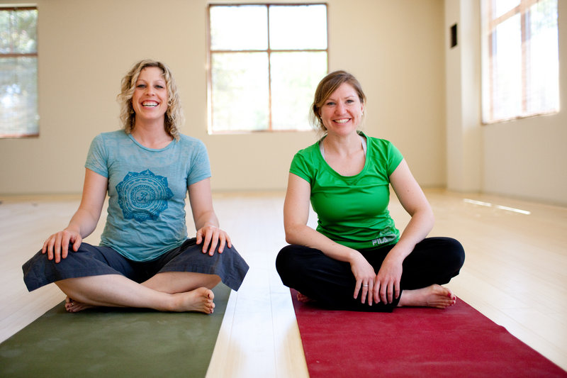 "Heidi MacVane, left, and Danielle Morin are co-owners of Greener Postures Yoga, which recently opened at 740 Broadway in South Portland. The studio offers vinyasa flow yoga classes, defined as ""breathing synchronized movement."""