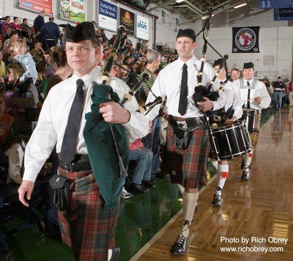 The Claddagh Mhor Pipe Band marches off the basketball court after its performance during a Maine Red Claws basketball game. Pictured, from left, are Ray O'Donnell, Paul Halvorsen, Jodi Ryan and Donald Oakes.