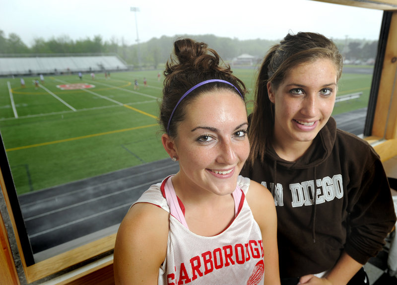 Brittany Ross, left, and Ellie Morin of Scarborough know what it's like to win Class A state titles – they've already done it in field hockey and basketball – and now they're urging their unbeaten lacrosse teammates. The Red Storm will meet Kennebunk in a regional semifinal.