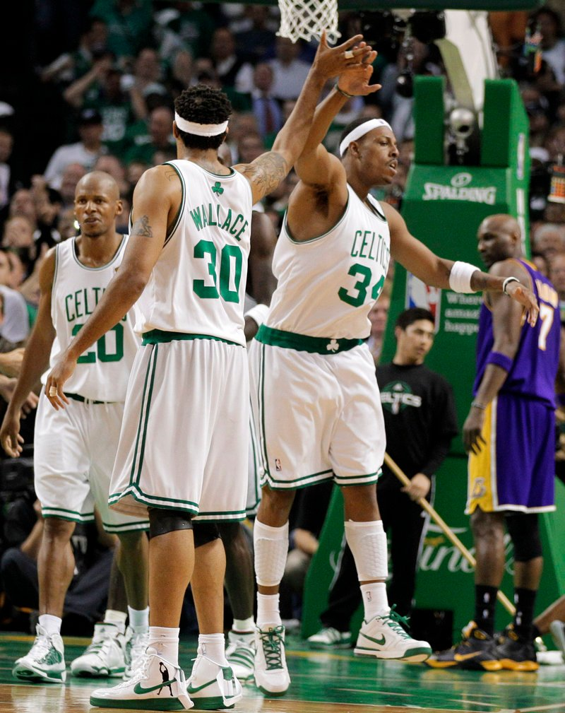 Rasheed Wallace and Paul Pierce of the Boston Celtics celebrate a fourth-quarter basket Thursday night. The Celtics won 96-89 to even the NBA final series at 2-2.
