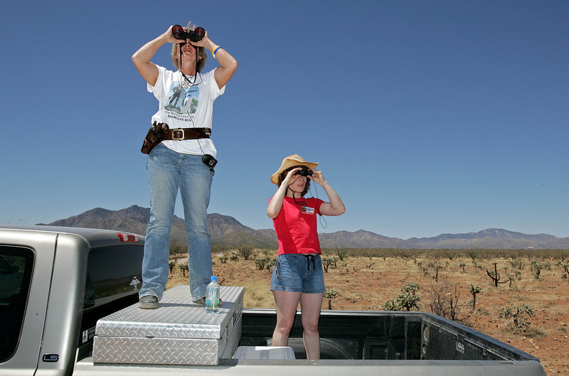 Carmen Mercer, left, of Tombstone, Ariz., and Lisa Hall of Chicago patrol the southwestern desert near Sasabe, Ariz., in this 2006 file photo. Both women are part of the Minuteman Project monitoring the border.