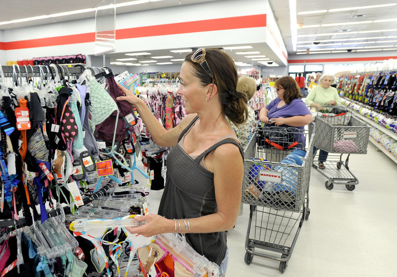 Shannan Burnell of Falmouth checks out the prices of swimsuits at Marden's Scarborough store on Friday. The chain, based in Waterville, has 15 stores across the state.