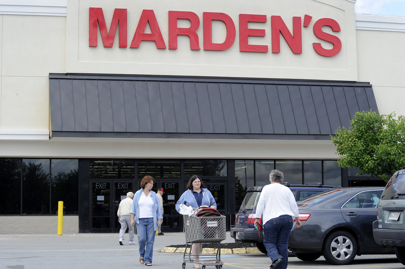 Bonnie Cleaves and her mother, Jenny Babine, both of Brunswick, leave Marden's 119,000-square-foot Scarborough store with a cart full of purchases Friday, the day the chain opened the Payne Road location. Its Portland store will close in the next month or two.