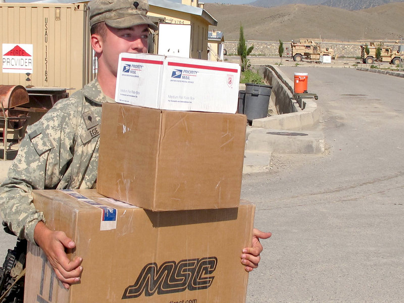Pfc. Craig Ege of Sanford does some heavy lifting Friday during Bravo Company's mail delivery at Combat Outpost Dand wa Patan.