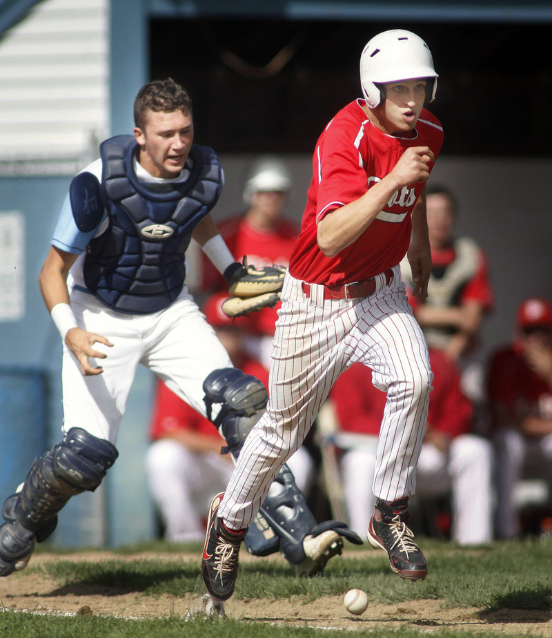 Paul Reny of South Portland dashes down the first-base line as Westbrook catcher Tom Lemay prepares to field the dribbler in front of the plate at Olmsted Field.