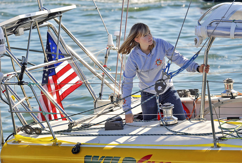 Sixteen-year-old Abby Sunderland looks out from her sailboat, Wild Eyes, as she leaves for her world record-attempting journey at the Del Rey Yacht Club in Marina del Rey, Calif., on Jan. 23.