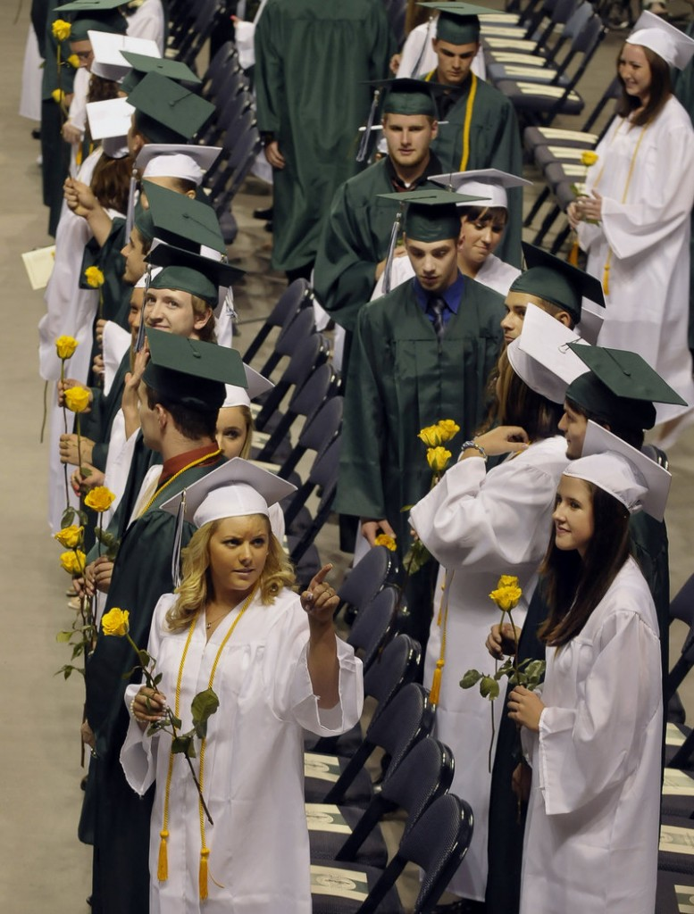 Graduates look for family and friends Friday as they file into the Cumberland County Civic Center in Portland for Bonny Eagle High School's graduation exercises. Altogether, 273 seniors received diplomas at ceremonies that went off without a hitch.