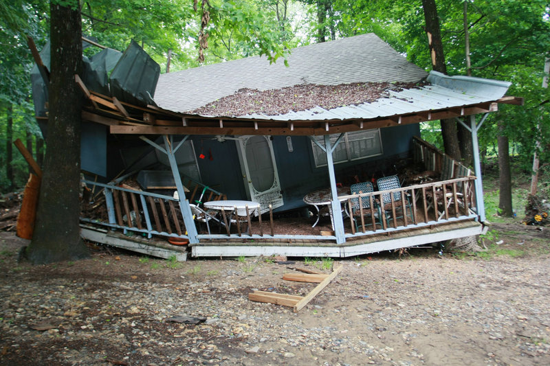 Damage is seen Friday in Langley, Ark., after rain caused a flash flood along the Little Missouri River. Forecasters had warned of the approaching danger during the night, but campers could have missed those advisories because the area is isolated.