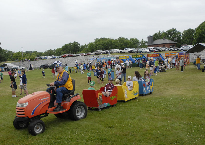 Norm Jordan of the Cape Elizabeth Lions Club drives a train filled with kids.