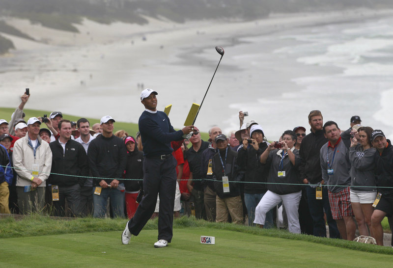 Tiger Woods watches his tee shot on the 14th hole Monday during a practice round of the U.S. Open in Pebble Beach, Calif. The course is dramatically different – and far more difficult – than it was four months ago.