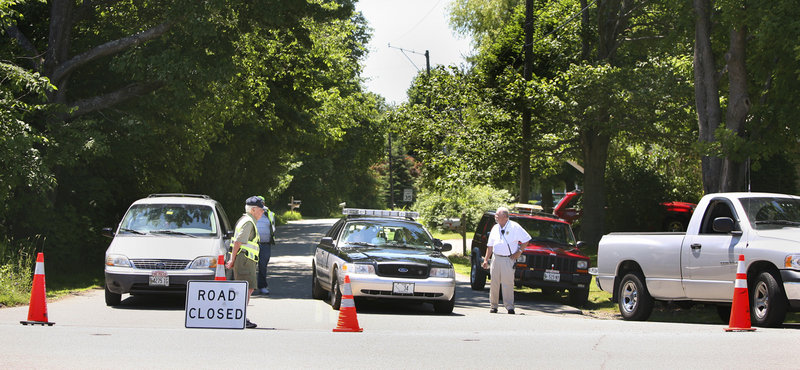 Members of the Scarborough Fire and Police Department block access to Ross Road off Pine Point Road in Scarborough after the federal Bureau of Alcohol, Tobacco, Firearms and Explosives raided a home Tuesday on Sandy Circle in Old Orchard Beach.