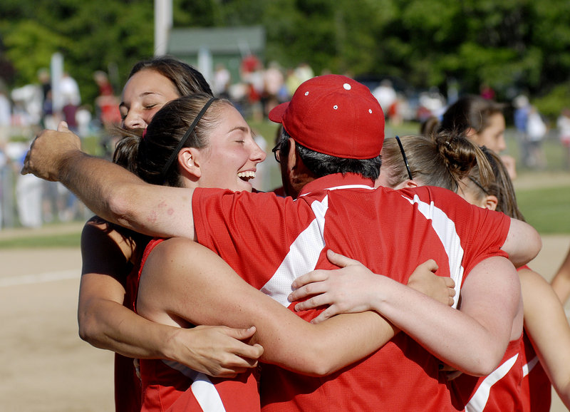 South Portland Coach Ralph Aceto joins his players in celebrating a 5-2 victory Tuesday over defending state champion Scarborough in the Western Class A title game.