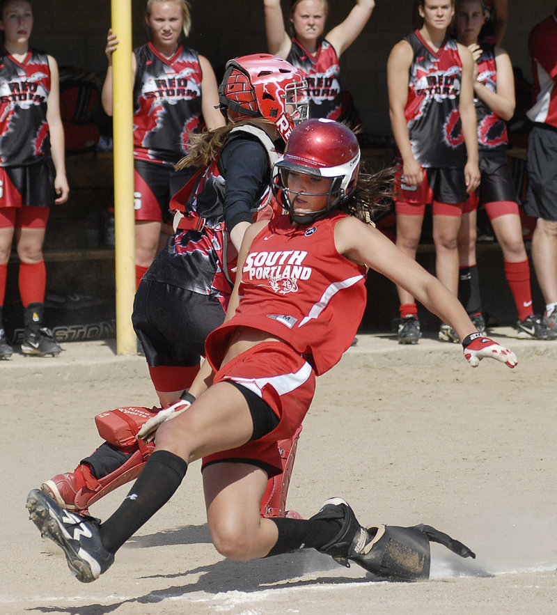 Erin Bogdanovich slides home with South Portland's first run in the third inning. The Riots had lost 12 of their previous 13 games against Scarborough.