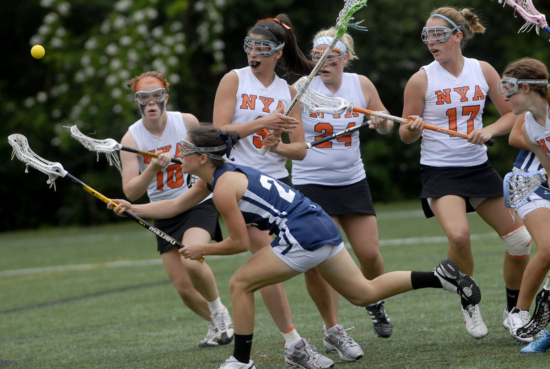 Danielle Torres of Yarmouth tries to beat a host of North Yarmouth Academy defenders to the ball during the Eastern Class B girls' lacrosse final Wednesday at Yarmouth. Top-seeded NYA advanced to the state final with a 9-5 victory.