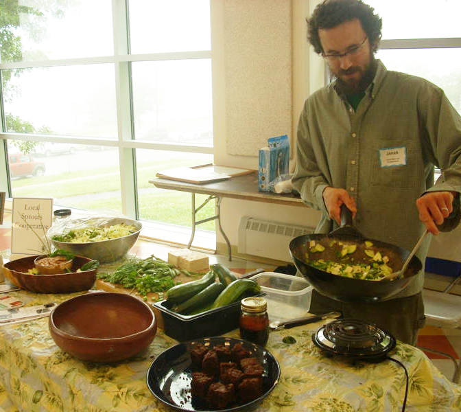 Jonah Fertig of Local Sprouts Cafe served up free samples of vegetarian eats made from local ingredients at the 2009 Vegetarian and Vegan Food Festival.