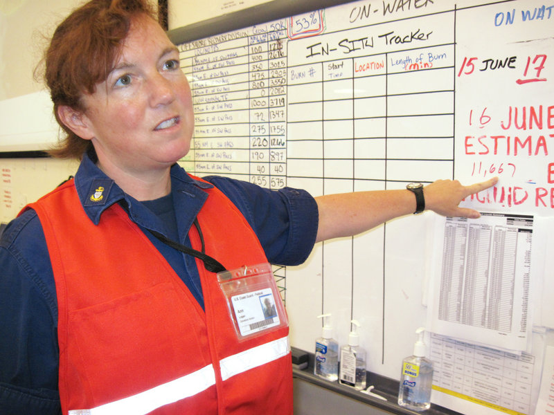 Coast Guard Marine Science Technician Ann Logan of Westbrook has been directing oil-skimming boats off the coast.