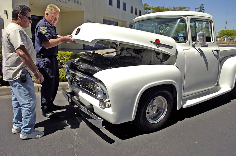 Harold Voelker and California Highway Patrol Officer Greg Bennett check out the 1956 Ford F-100 truck that was stolen from Voelker in 1972 and recovered only this week. Bennett ID'd the long-lost vehicle.