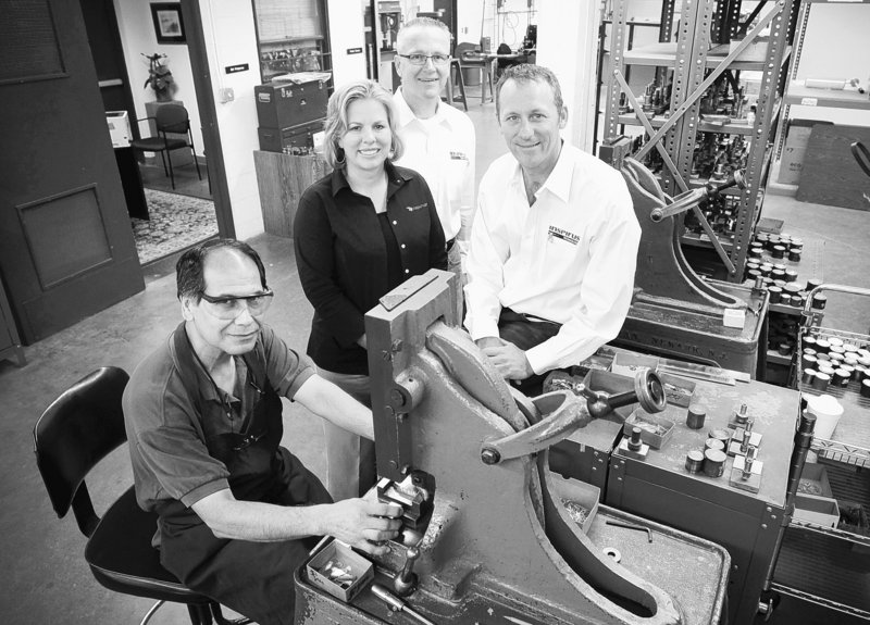 Inspirus, a company based in Fort Worth, Texas, that designs retention and recognition programs, has seen a boost in business as the economy slowly comes back and employers try to find ways to keep employees who made it through all the hardships. From left are Frank Torres, Kimberly Smithson-Abel, Michael Cobb, president, and CEO Pete Chambers.