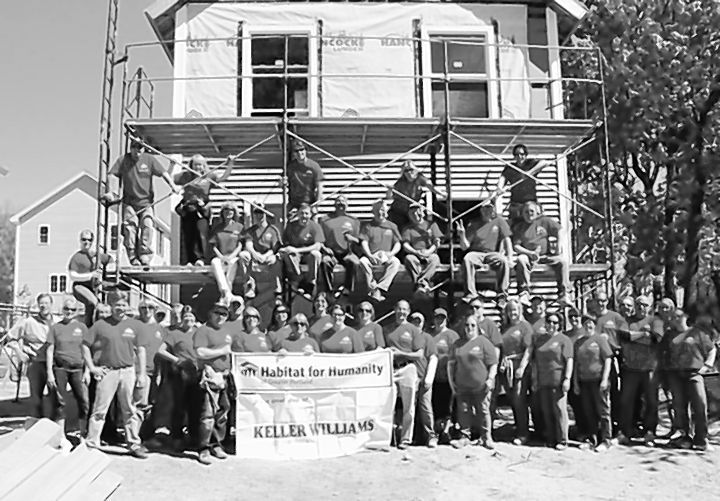 Associates from Keller Williams pose at a Habitat for Humanity project while participating in the second annual Renew, Energize and Donate Day. More than 80 associates donated their time, labor and money, raising $2,400 for the cause.