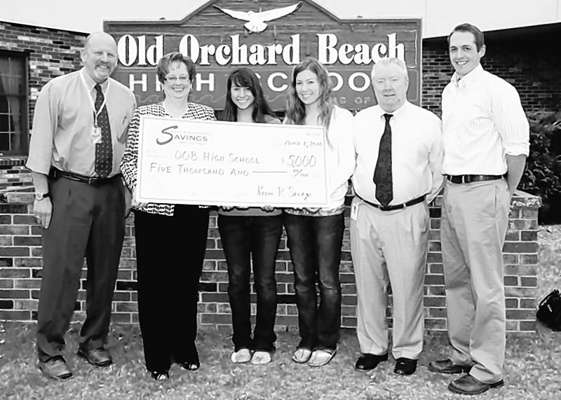 Saco & Biddeford Savings Institution donated $5,000 toward an electronic message board to keep Old Orchard Beach High School students abreast of school activities and events.