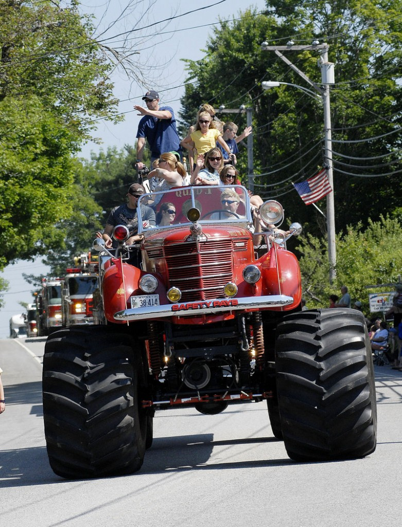 Camp Sunshine's entry precedes a fleet of firetrucks during Windham's Summerfest-launching parade Saturday. The organization also hosted a free Kids Zone with games for tots.