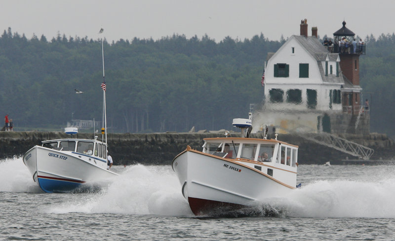 Quick Step, left, and Emily Grace head down the race course during the lobster boat races in Rockland on Sunday. More than 110 boats raced in Maine over the weekend as the annual lobster boat racing season kicked off. Sixty-nine boats competed Sunday in Rockland.
